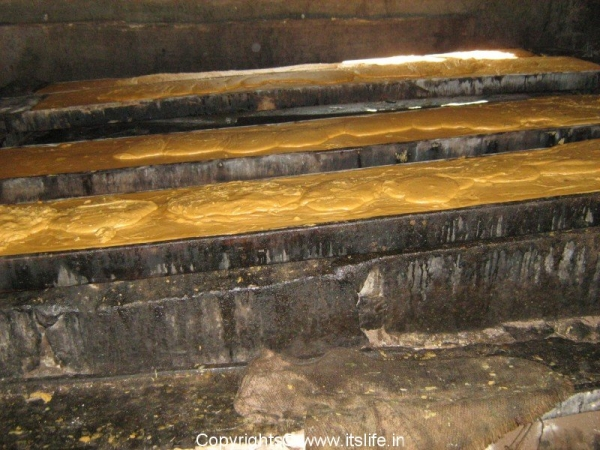 Semi solid Jaggery poured into moulds