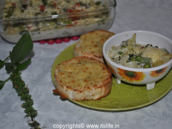 Vegetables baked in White Sauce